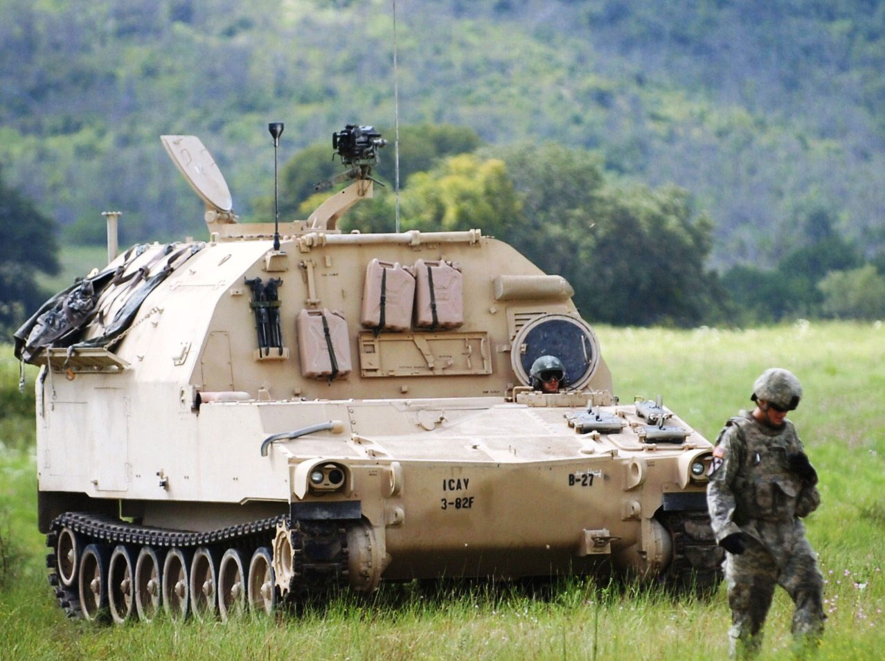 FORT HOOD, Texas— Artillerymen from B. Battery, 3rd Battalion, 82nd Field Artillery Regiment, 2nd Brigade Combat Team, 1st Cavalry Division, move a M992A2 Field Artillery Ammunition Supply Vehicle across the range to a M109A6 Paladin to provide support during the 3rd Bn, 82nd FA Regt.'s Paladin live-fire exercise at a range on Fort Hood, Sept. 22. (U.S. Army photo by Sgt Quentin Johnson, 2nd BCT PAO, 1st Cav. Div.)